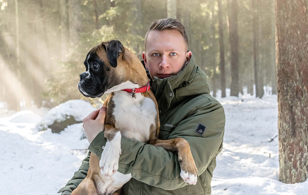 german boxer with owner